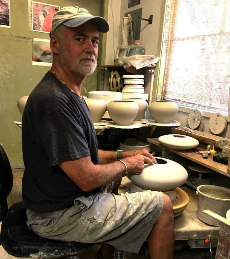 Michael Adcock at the potter's wheel