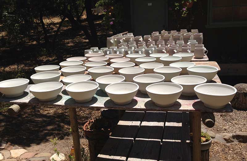 ceramic bowls lined up ready for kiln firing