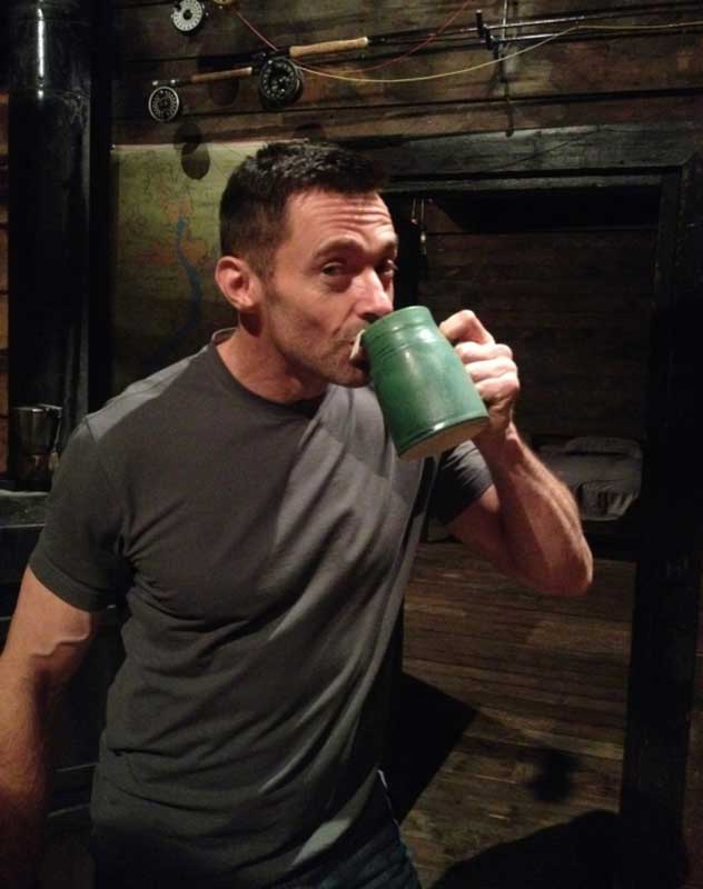 man drinking from mug made by Michael Adcock
