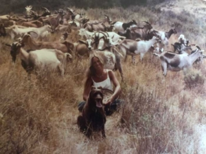 Christine Love Adcock as young woman goat herding