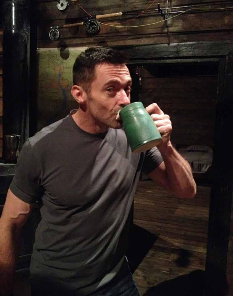 man drinking from mug