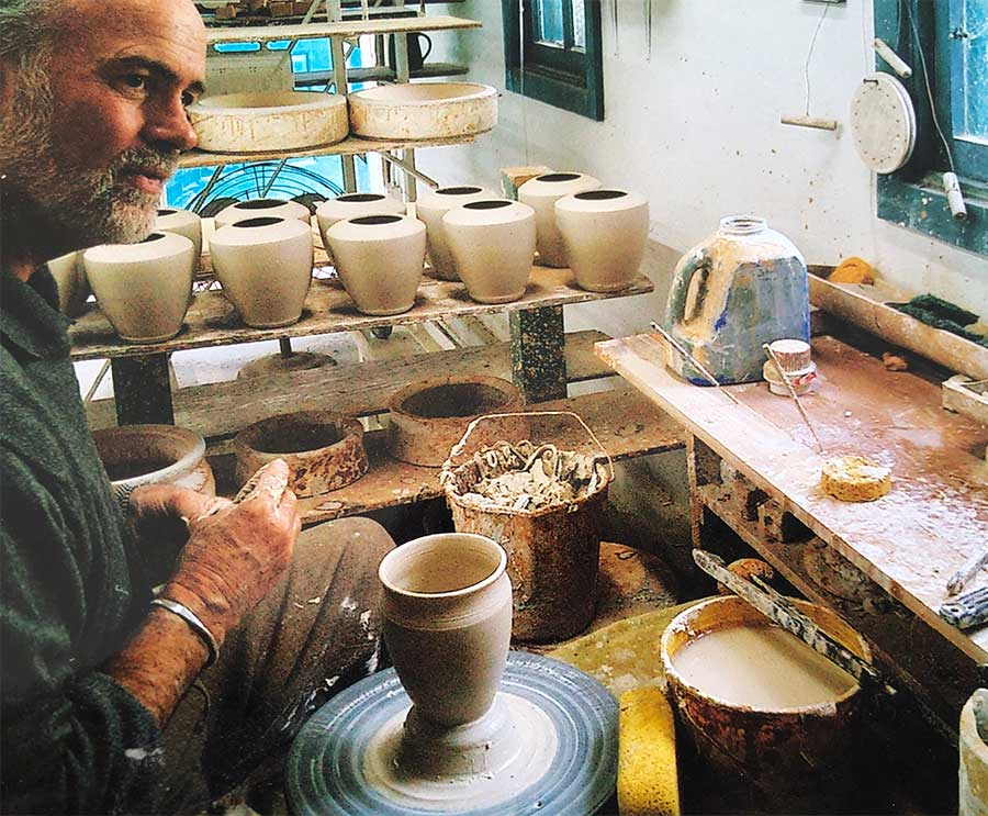 potter Michael Adcock working at work in the studio